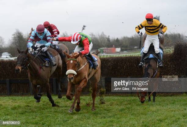 Fentara and Daryl Jacob fall as eventual winner Harris Hawk and John Dawson jump the final fence in the Buy Your 2013 Annual Badge Today Handicap...