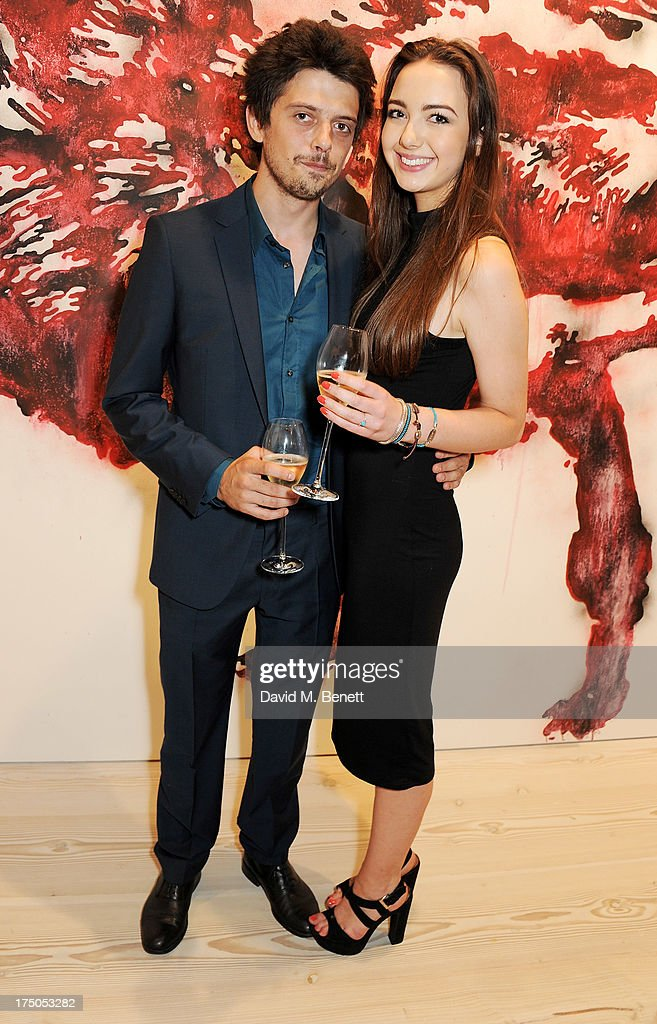 Fenton Bailey (L) and guest attend a private view of 'HUGO: Red Never Follows', celebrating 20 years of Hugo Boss, at the Saatchi Gallery on July 30, 2013 in London, England.