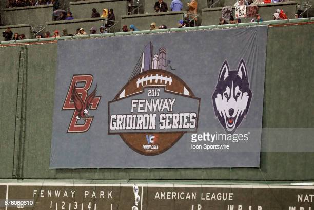 Fenway's Green Monster displays the game banner during a game between the UCONN Huskies and the Boston College Eagles on November 18 at Fenway Park...