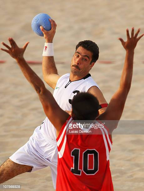 Feraidoon Mirzayar of Afghanistan is challenged by Rudi Affandi of Indonesia in the Beach Handball match between Indonesia and Afghanistan at...