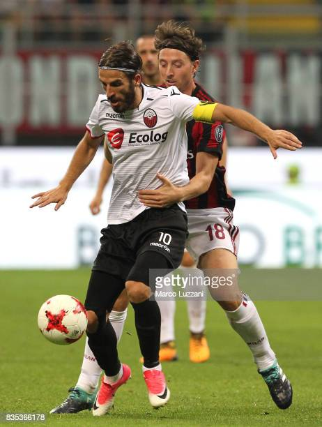 Feran Hasani of KF Shkendija 79 competes for the ball with Riccardo Montolivo of AC Milan during the UEFA Europa League Qualifying PlayOffs round...