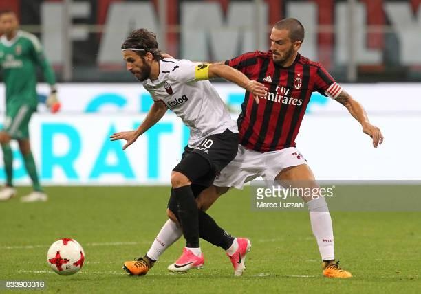Feran Hasani of KF Shkendija 79 is challenged by Leonardo Bonucci of AC Milan during the UEFA Europa League Qualifying PlayOffs round first leg match...