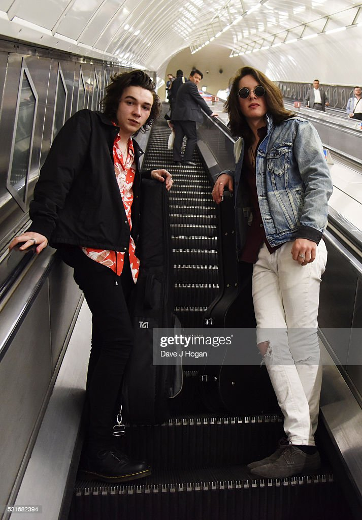 Ferdia Walsh-Peelo (R) and Mark McKenna busking to promote the upcoming film 'Sing Street,' which is released to theatres May 20th, at Leicester Square Station on May 16, 2016 in London, England.