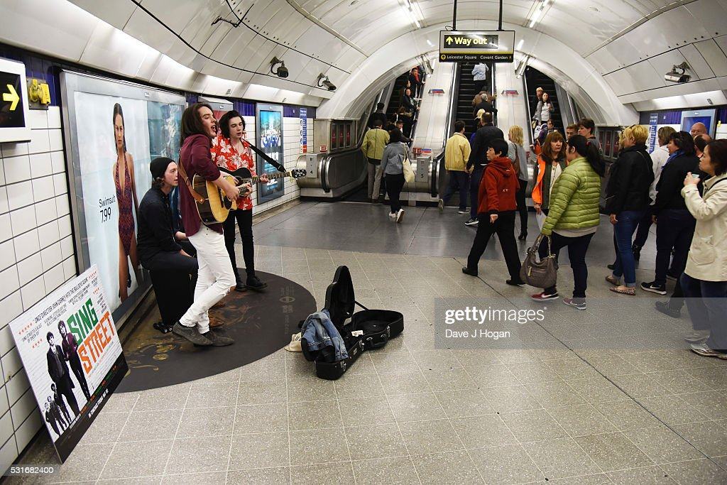 Ferdia Walsh-Peelo (L) and Mark McKenna busking to promote the upcoming film 'Sing Street,' which is released to theatres May 20th, at Leicester Square Station on May 16, 2016 in London, England.
