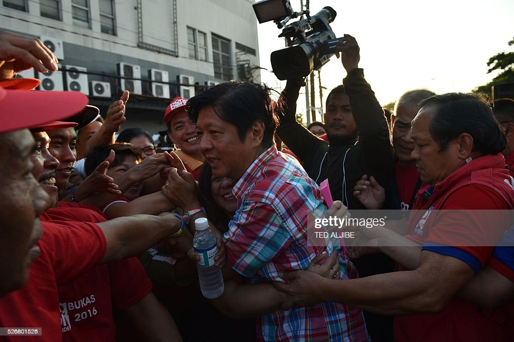Ferdinand Marcos Jnr, Philippine vice-Presidential candidate and son of the late dictator Ferdinand Marcos is mobbed by supporters as he arrives for a political campaign rally in Manila on May 1, 2016. On the verge of securing his family's biggest victory since their humiliating downfall three decades ago, Philippine dictator Ferdinand Marcos's son talks confidently about his political ambitions and his father's legacy. / AFP / TED