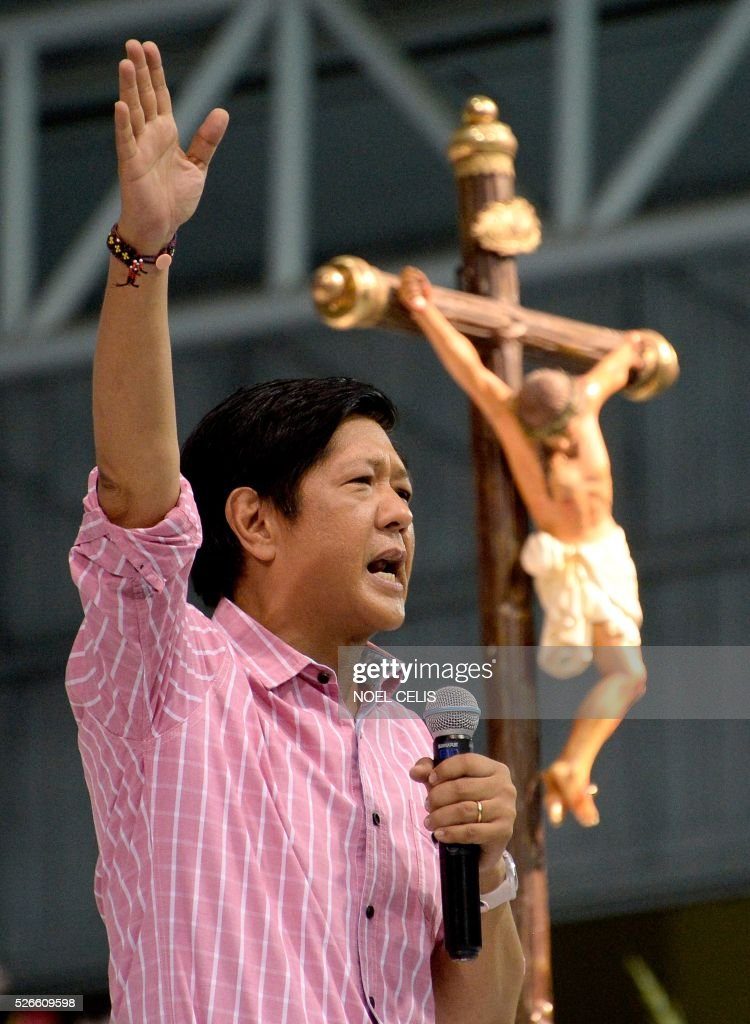 Ferdinand Marcos Jr., son of the late Philippine dictator Ferdinand Marcos, and a vice-presidential candidate for the May 9 elections speaks during the Pro-Catholic Born again religious group El Shaddai prayer vigil overnight celebration in Manila on May 1, 2016. More than 17,000 positions ranging from president to town councillors will be contested when the Philippines holds national elections on May 9, 2016. About 80 percent of the Philippines' 100 million people are Catholic, a legacy of Spanish colonial rule that ended in the late 1800s. / AFP / NOEL