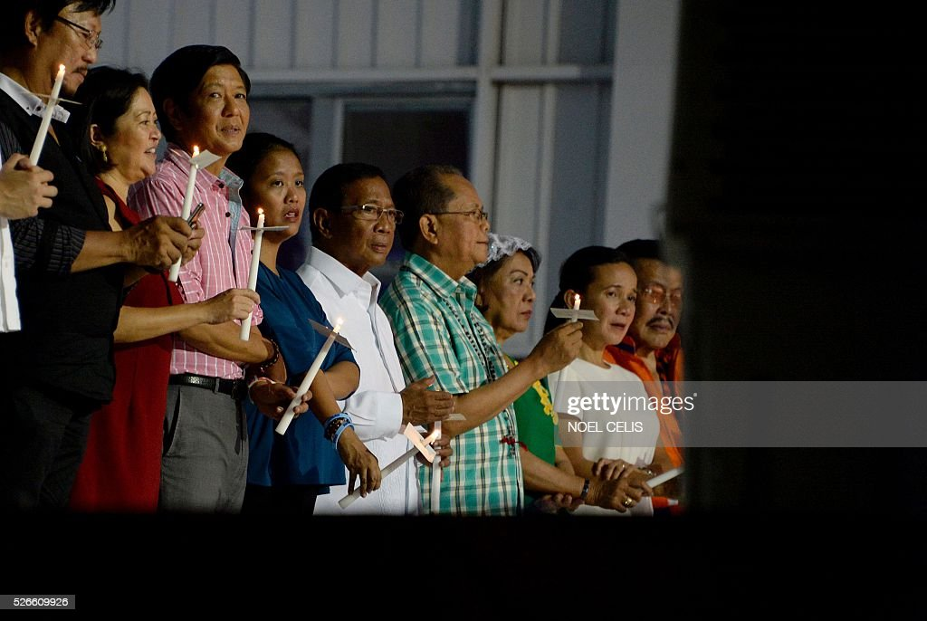 Ferdinand Marcos Jr., son of the late Philippine dictator Ferdinand Marcos and a vice-presidential candidate for the May 9 elections (3rd L) and Philippine Presidential candidate and Vice President Jejomar Binay (5th L), Head of El Shaddai Mike Velarde (4th R), Philippine Presidential candidate Senator Grace Poe (2nd R), and Manila Mayor and former President Joseph Estrada at the Pro-Catholic Born again religious group El Shaddai prayer vigil overnight celebration in Manila on May 1, 2016. More than 17,000 positions ranging from president to town councillors will be contested when the Philippines holds national elections on May 9, 2016. About 80 percent of the Philippines' 100 million people are Catholic, a legacy of Spanish colonial rule that ended in the late 1800s. / AFP / NOEL