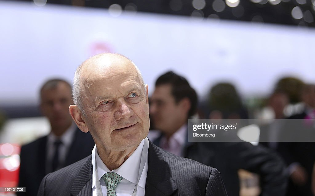 Ferdinand Piech, chairman of Volkswagen AG, passes through a display of automobiles at the company's annual general meeting (AGM) in Hanover, Germany, on Thursday, April 25, 2013. Volkswagen AG, Europe's biggest automaker, aims to offset plunging European demand this year by rolling out 60 new and updated models, including luxury cruisers like the Bentley Flying Spur. Photographer: Chris Ratcliffe/Bloomberg via Getty Images