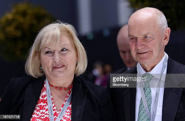 Ferdinand Piech chairman of Volkswagen AG right and his wife Ursula Piech a member of the executive board at Volkswagen AG look at a display of cars...