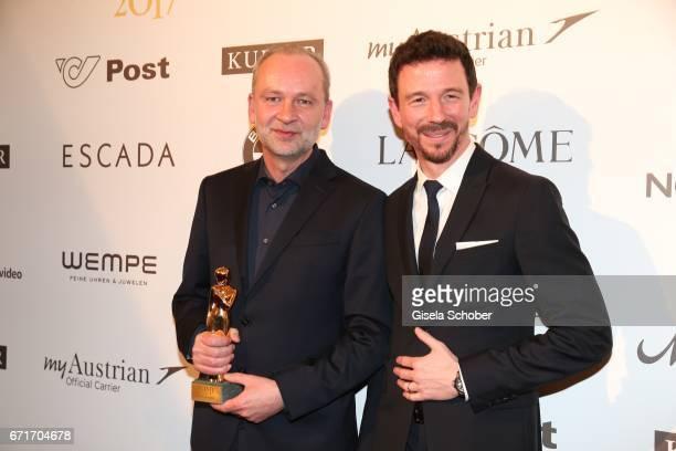 Ferdinand von Schirach and Oliver Berben with award during the ROMY award at Hofburg Vienna on April 22 2017 in Vienna Austria