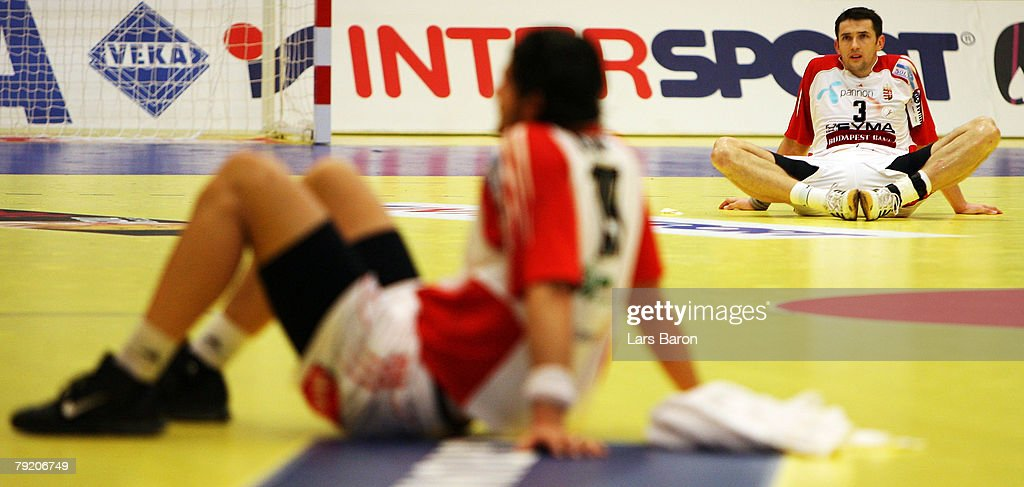 Ferenc Ilyes of Hungary (R) sits dejected on the floor after loosing the Men's Handball European Championship main round Group II match between Hungary and Iceland at Trondheim Spektrum on January 23, 2008 in Trondheim, Norway.