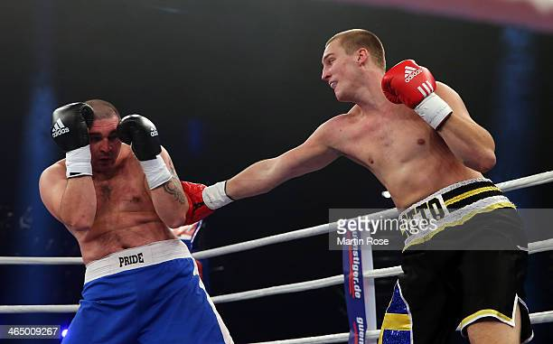 Ferenc Zsalek of Hungary exchanges punches with Otto Wallin of Sweden during their heavy weight fight at HansMartinSchleier on January 25 2014 in...