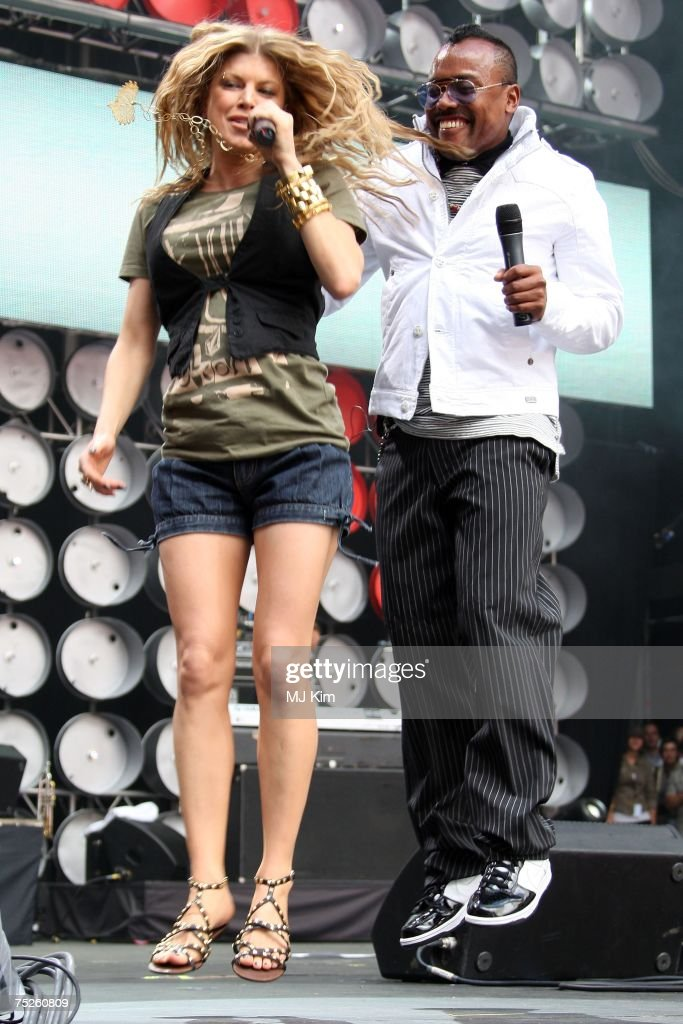 Fergie and apldeap of American hiphop group Black eyed Peas perform onstage during the Live Earth concert held at Wembley Stadium on July 7 2007 in...