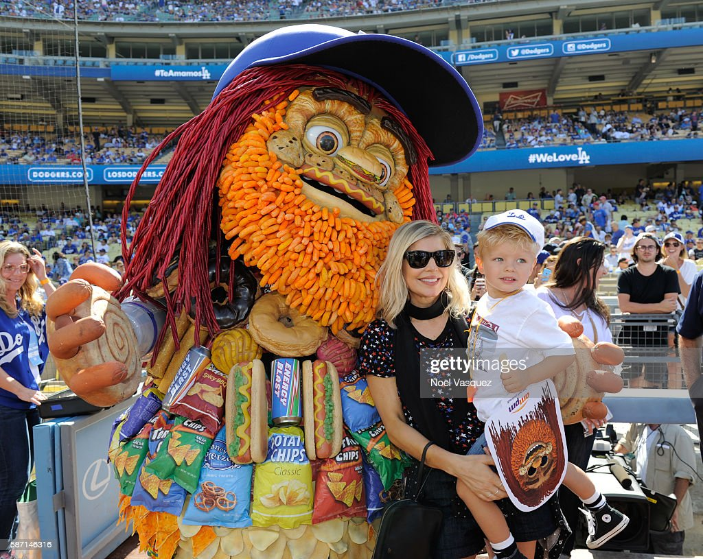 Fergie and Axl Jack Duhamel meet Toomgis before a game between the Boston Red Sox and the Los Angeles Dodgers at Dodger Stadium on August 7 2016 in...