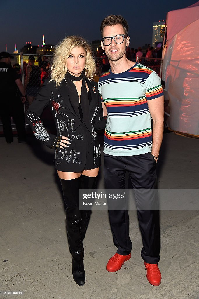 Fergie and <a gi-track='captionPersonalityLinkClicked' href=/galleries/search?phrase=Brad+Goreski&family=editorial&specificpeople=3255296 ng-click='$event.stopPropagation()'>Brad Goreski</a> pose backstage before she performs on stage during New York City Pride 2016 - Dance On The Pier at Pier 26 on June 26, 2016 in New York City.