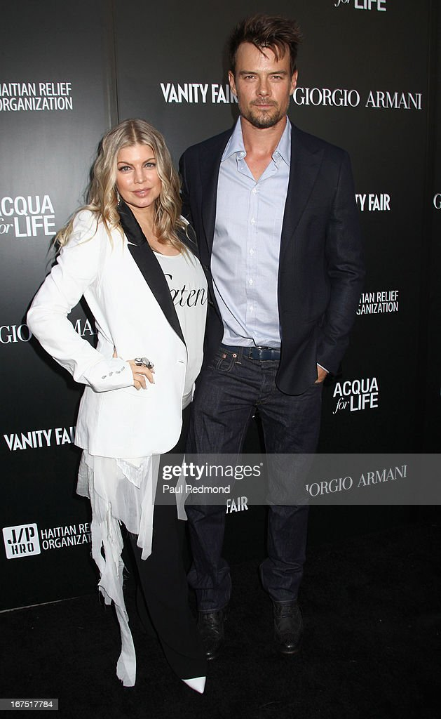 Fergie and <a gi-track='captionPersonalityLinkClicked' href=/galleries/search?phrase=Josh+Duhamel&family=editorial&specificpeople=208740 ng-click='$event.stopPropagation()'>Josh Duhamel</a> arrive at the Armani party during Paris Photo LA - Opening Night at Paramount Studios on April 25, 2013 in Hollywood, California.
