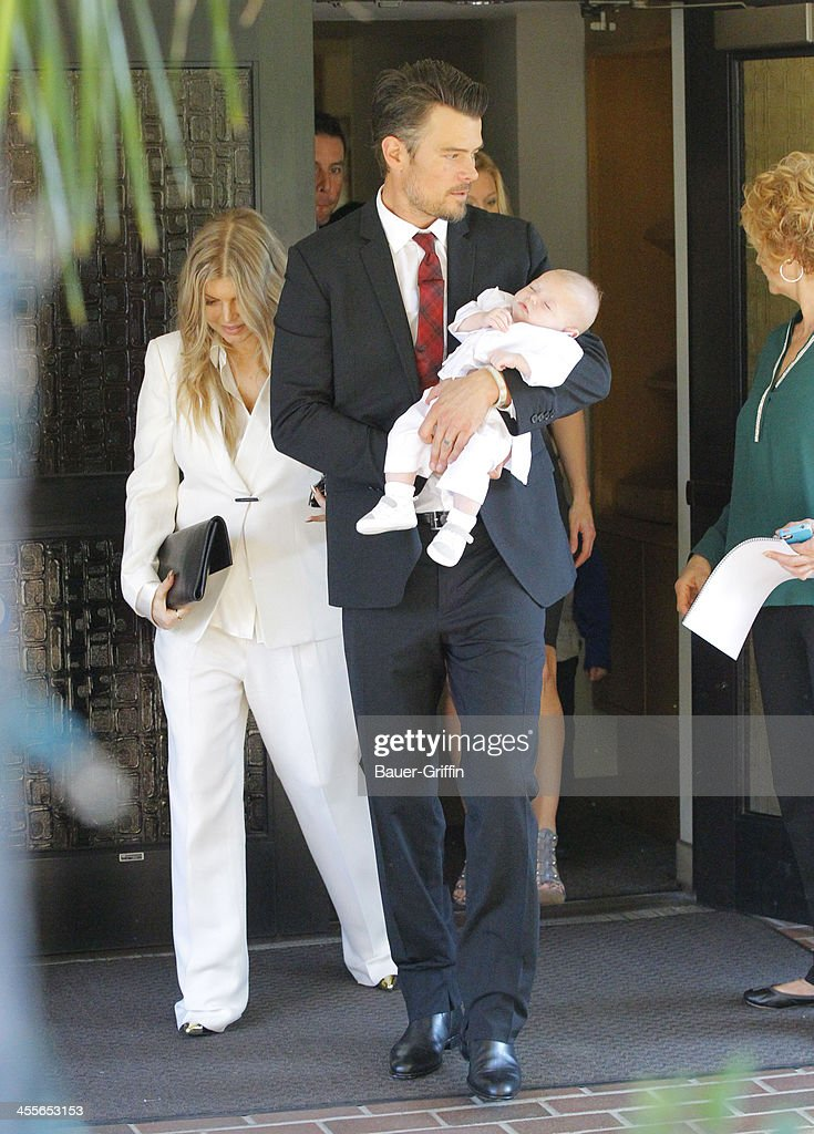 Fergie and <a gi-track='captionPersonalityLinkClicked' href=/galleries/search?phrase=Josh+Duhamel&family=editorial&specificpeople=208740 ng-click='$event.stopPropagation()'>Josh Duhamel</a> with son Axl Duhamel are seen on December 12, 2013 in Los Angeles, California.