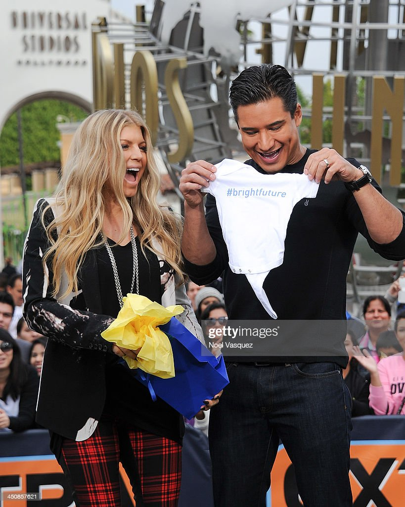 Fergie (L) and <a gi-track='captionPersonalityLinkClicked' href=/galleries/search?phrase=Mario+Lopez&family=editorial&specificpeople=235992 ng-click='$event.stopPropagation()'>Mario Lopez</a> visit 'Extra' at Universal Studios Hollywood on November 20, 2013 in Los Angeles, California.