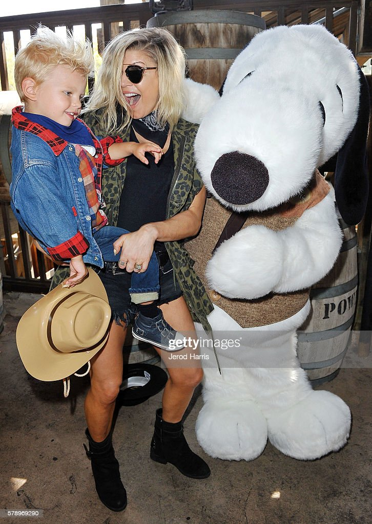 Fergie and son Axl visit Camp Snoopy and the relaunch of GhostRider at Knott's Berry Farm on July 14 2016 in Buena Park California