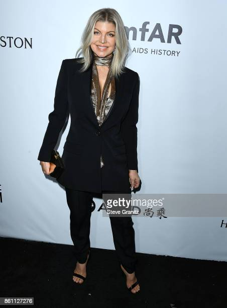 Fergie arrives at the amfAR Los Angeles 2017 at Ron Burkle's Green Acres Estate on October 13 2017 in Beverly Hills Californi