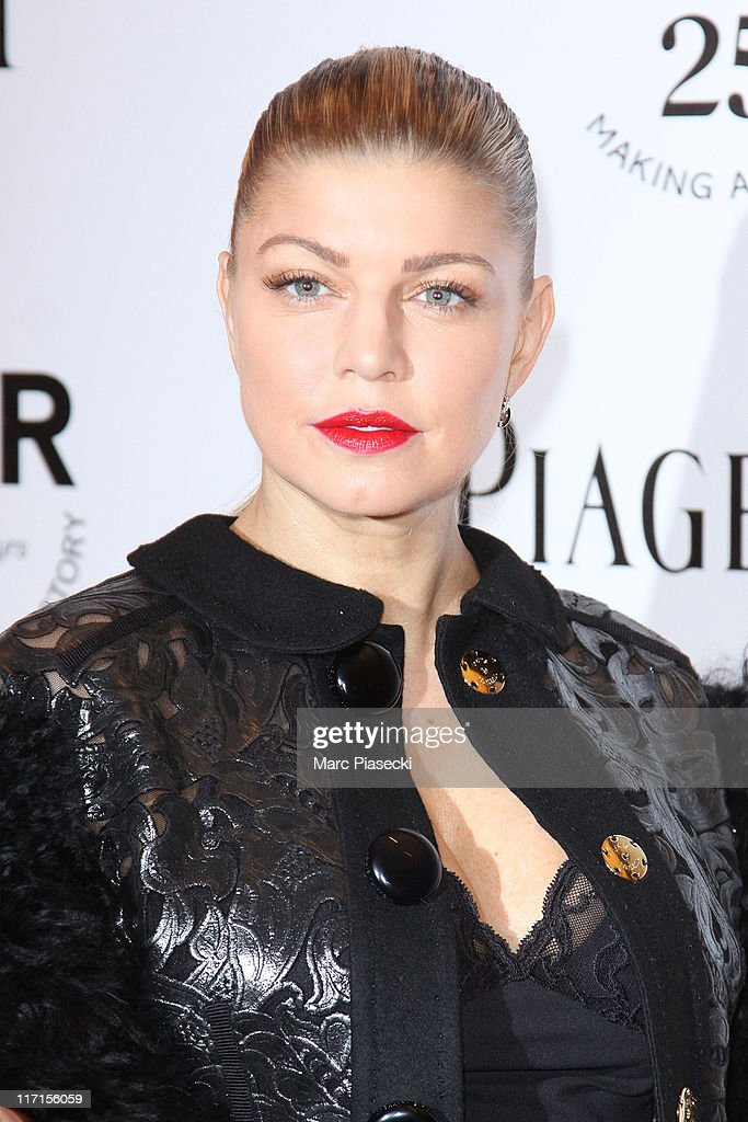 Fergie attends the amfAR Inspiration Gala photocall at Pavillon Gabriel on June 23, 2011 in Paris, France.