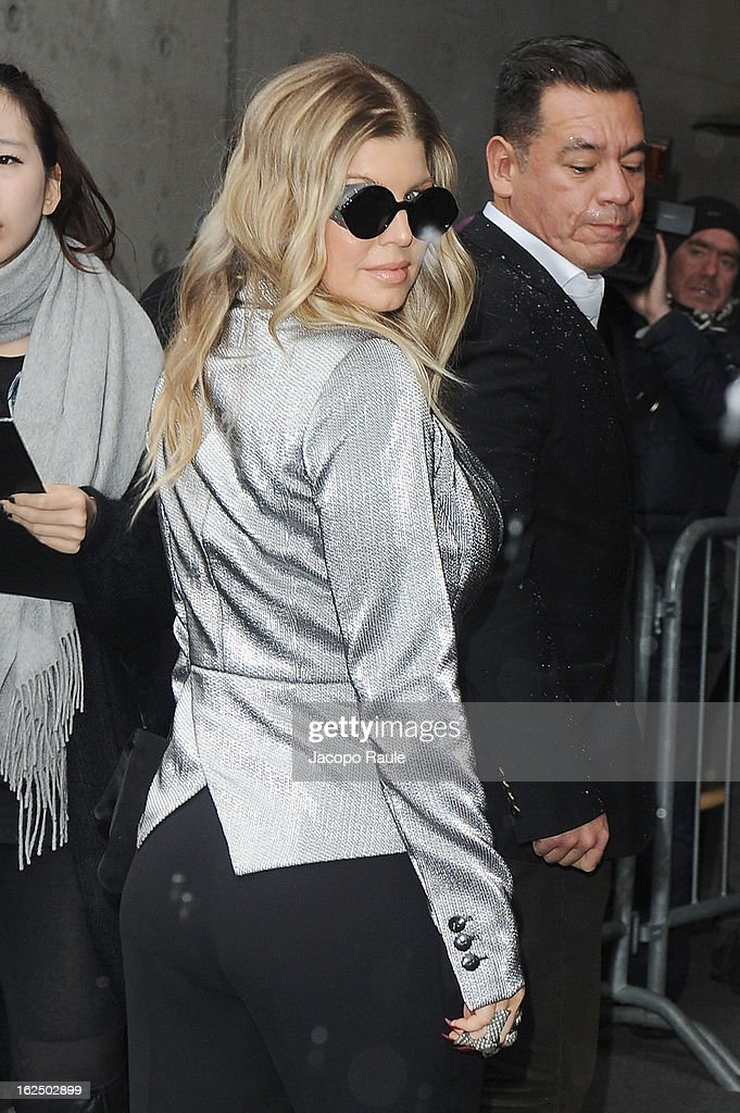 Fergie attends the Emporio Armani fashion show as part of Milan Fashion Week Womenswear Fall/Winter 2013/14 on February 24, 2014 in Milan, Italy.