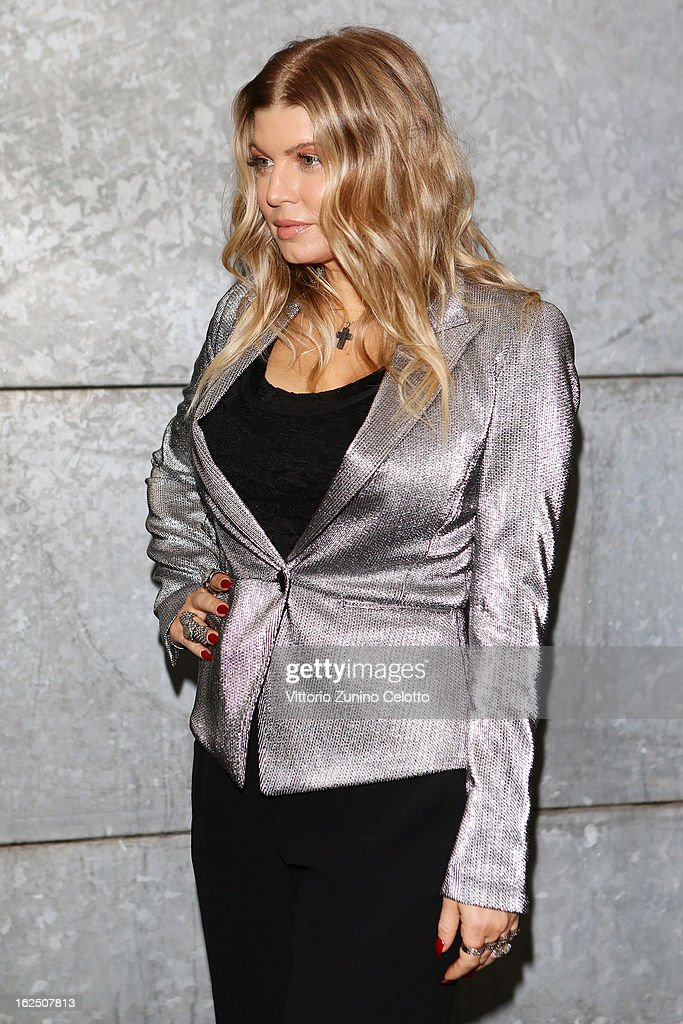 Fergie attends the Emporio Armani fashion show during Milan Fashion Week Womenswear Fall/Winter 2013/14 on February 24, 2013 in Milan, Italy.
