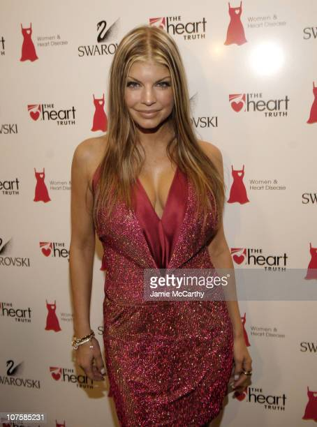 Fergie during Olympus Fashion Week Fall 2006 Swarovski Red Dress Fashion Show at Bryant Park in New York City New York