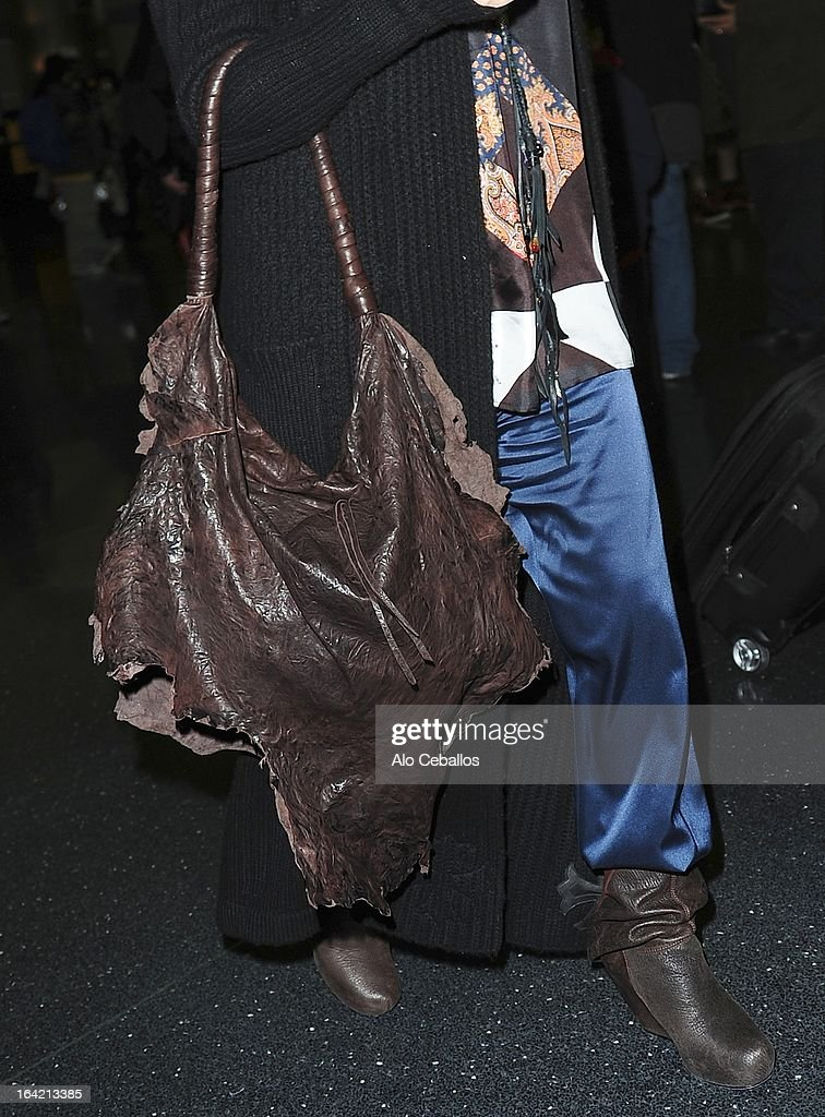 Fergie (shoe and purse detail) is seen at JFK Airport on March 20, 2013 in New York City.