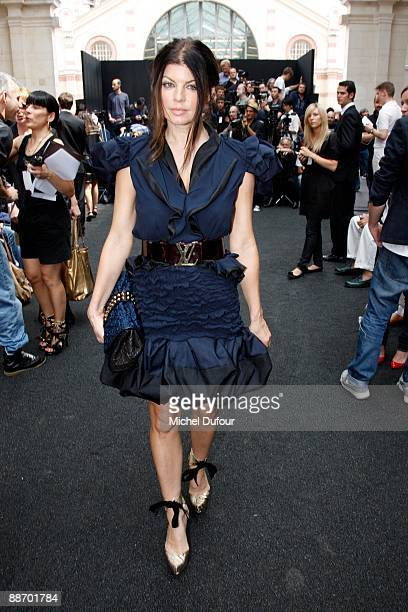 Fergie of Black Eyed Peas attends the Louis Vuitton show as part of Paris Menswear Fashion Week Spring/ Summer 2010 at Le 104 on June 25 2009 in...
