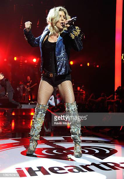 Fergie of Black Eyed Peas performs onstage at the iHeartRadio Music Festival held at the MGM Grand Garden Arena on September 23 2011 in Las Vegas...