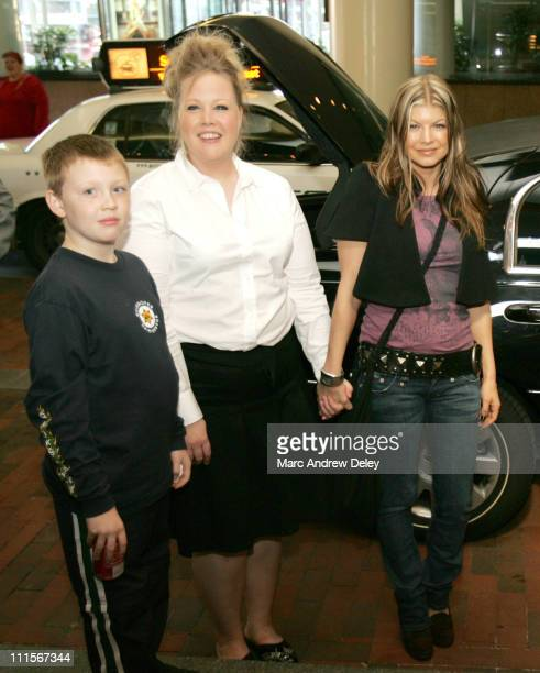 Fergie of Black Eyed Peas with contest winner Christi Ward and her nephew Christian Hennessey