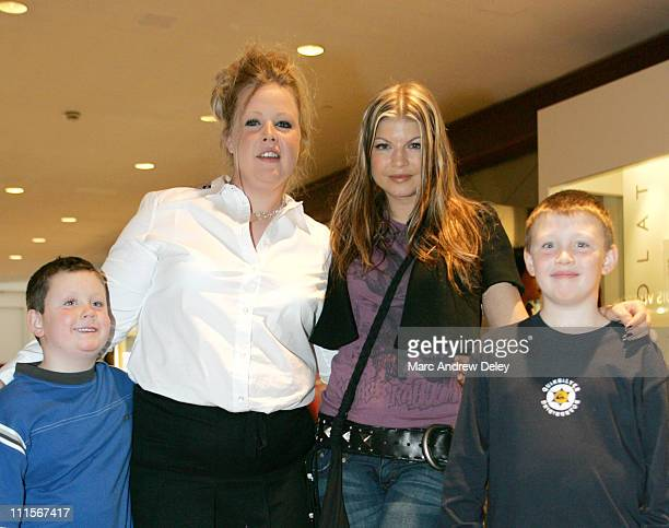 Fergie of Black Eyed Peas with contest winner Christi Ward and her nephews Patrick Hennessey and Christian Hennessey