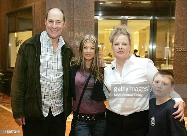 Fergie of Black Eyed Peas with Matt Siegel contest winner Christi Ward and her nephew Christian Hennessey