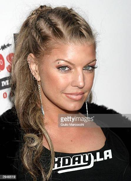 Fergie of the Black Eyed Peas arrives at the 2004 Rock the Vote Awards on February 7 2004 in Hollywood California