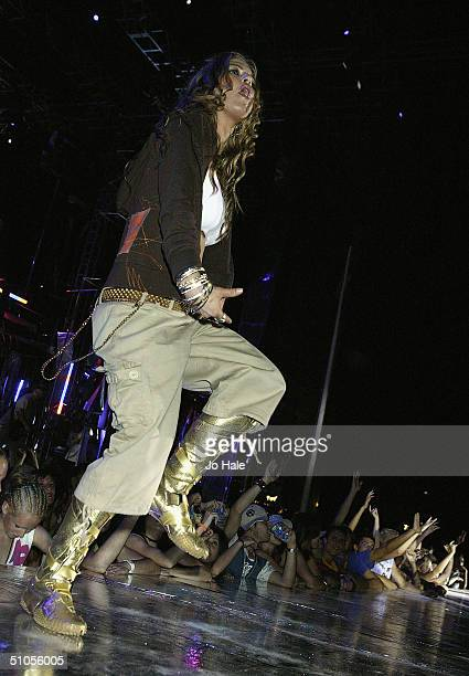 Fergie of the Black Eyed Peas performs at the annual 'Isle of MTV 2004' summer dance party event on the beach in Tossa De Mar on July 12 2004 in Spain