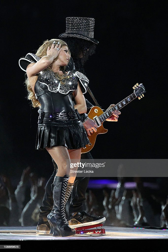 Fergie of the Black Eyed Peas performs with Slash during the Bridgestone Super Bowl XLV Halftime Show at Cowboys Stadium on February 6, 2011 in Arlington, Texas.