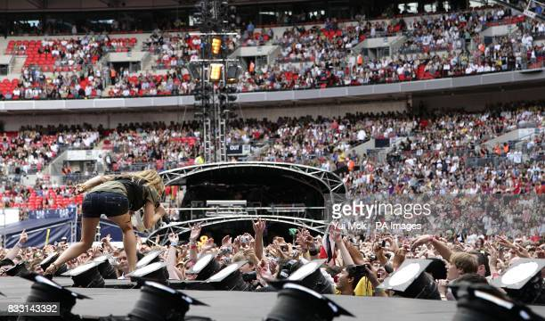 Fergie on stage during The Black Eyed Peas performance at the charity concert at Wembley Stadium London