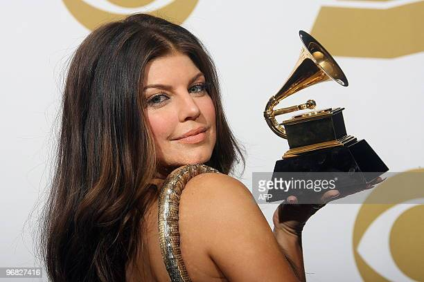 Fergie poses with her award during the 52nd annual Grammy Awards in Los Angeles California on January 31 2010 AFP PHOTO / VALERIE MACON