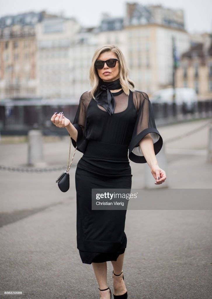 Fergie wearing black dress, scarf seen outside Givenchy during Paris Fashion Week Spring/Summer 2018 on October 1, 2017 in Paris, France.