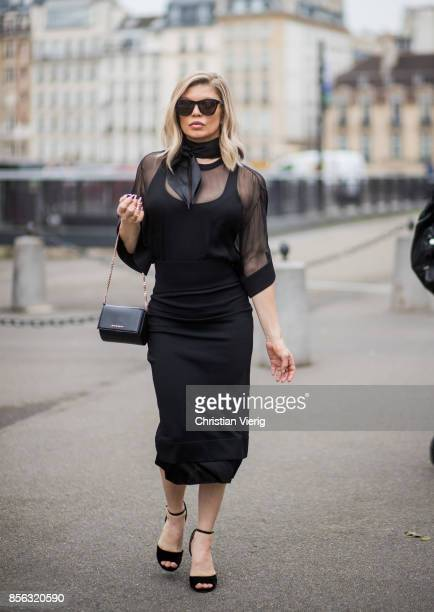 Fergie wearing black dress scarf seen outside Givenchy during Paris Fashion Week Spring/Summer 2018 on October 1 2017 in Paris France