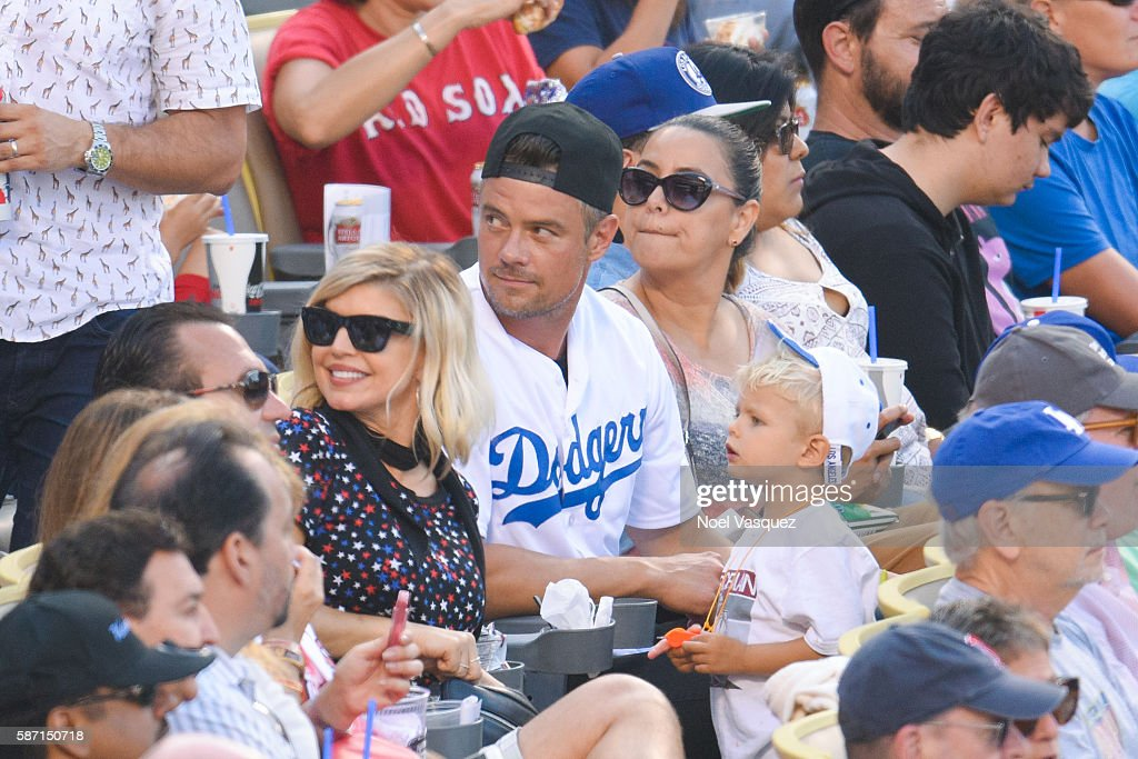 FergieJosh Duhamel and Axl Jack Duhamel attend a baseball game between the between the Boston Red Sox and the Los Angeles Dodgers at Dodger Stadium...