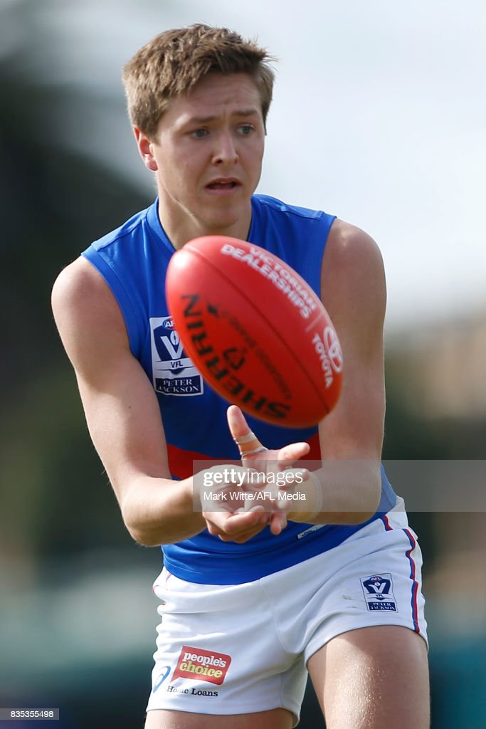Fergus Greene of Footscray Bulldogs handballs during the round 18 VFL match between the Essendon Bombers and Footscray Bulldogs at Windy Hill on August 19, 2017 in Melbourne, Australia.