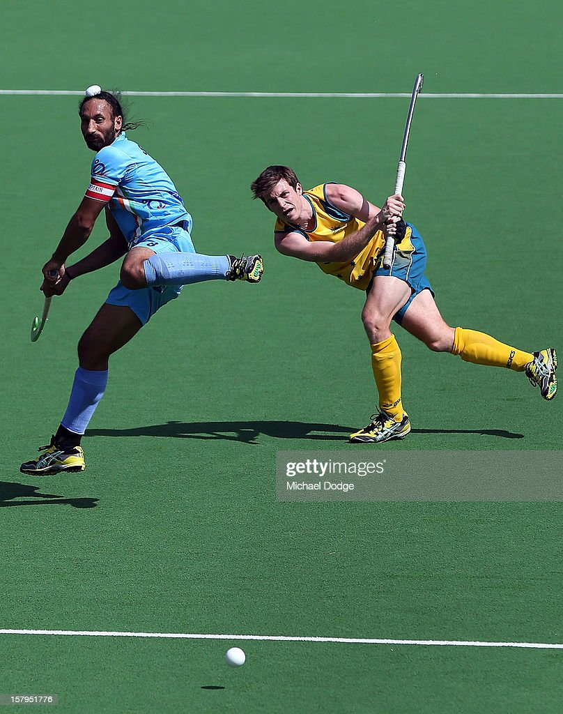 <a gi-track='captionPersonalityLinkClicked' href=/galleries/search?phrase=Fergus+Kavanagh&family=editorial&specificpeople=5431715 ng-click='$event.stopPropagation()'>Fergus Kavanagh</a> of Australia hits the ball past Sardar Singh of India in the match between Australia and India during day five of the 2012 Champions Trophy at the State Netball and Hockey Centre on December 8, 2012 in Melbourne, Australia.