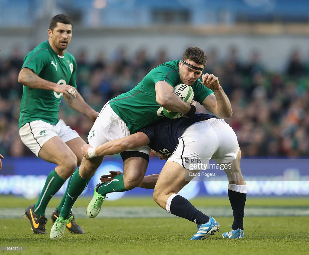 Fergus McFadden of Ireland is tackled during the RBS Six Nations match between Ireland and Scotland at the Aviva Stadium on February 2, 2014 in Dublin, Ireland.