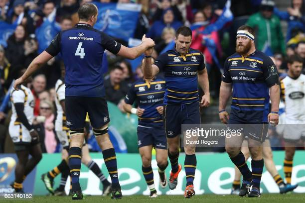 Fergus McFadden of Leinster is congratulated by Devin Toner of Leinster during the European Rugby Champions Cup quarter final match between Leinster...