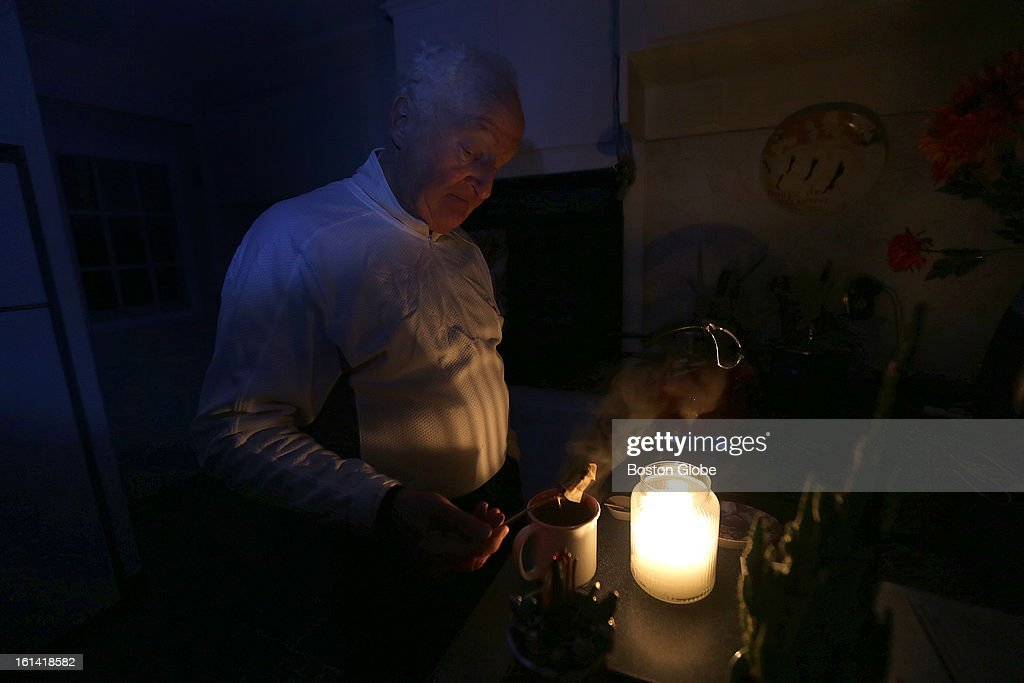 Fergus Moylan, 68, of Plymouth, fixes himself a cup of hot tea as he prepares to weather another night without power on Sunday, Feb. 10, 2013, after a blizzard hit New England.