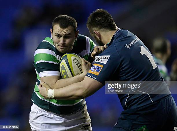 Fergus Mulchrone of London Irish is tackled during the LV= Cup Match between London Irish and Scarlets at the Madejski Stadium on February 1 2014 in...