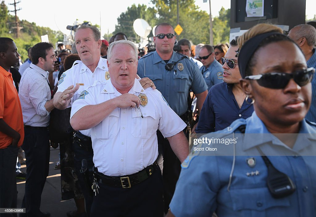 Ferguson Police Chief Thomas Jackson leaves the parking lot of a gas station, which was burned during rioting, after he announced the name of the Ferguson police officer responsible for the August 9, shooting death of teenager Michael Brown on August 15, 2014 in Ferguson, Missouri. The officer was identified as Darren Wilson, a six year veteran of the police department. Brown's killing sparked several days of violent protests in the city.