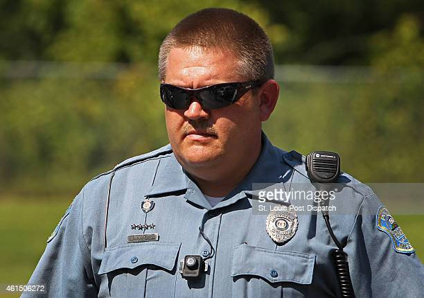 A Ferguson police officer wears a body camera while responding to a call about a possible theft from a residence in the Canfield Green Apartments on...